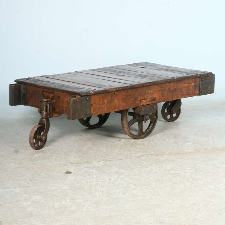 Antique vintage luggage cart coffee table circa 1920 with cast iron wheels at 1stdibs Coffee table antique