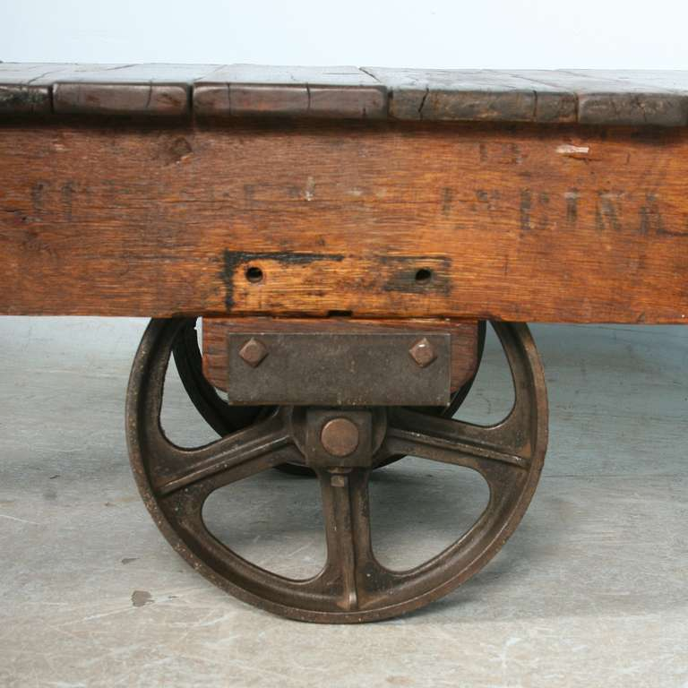 Antique Vintage Luggage Cart Coffee Table circa 1920 with Cast Iron Wheels In Excellent Condition In Round Top, TX