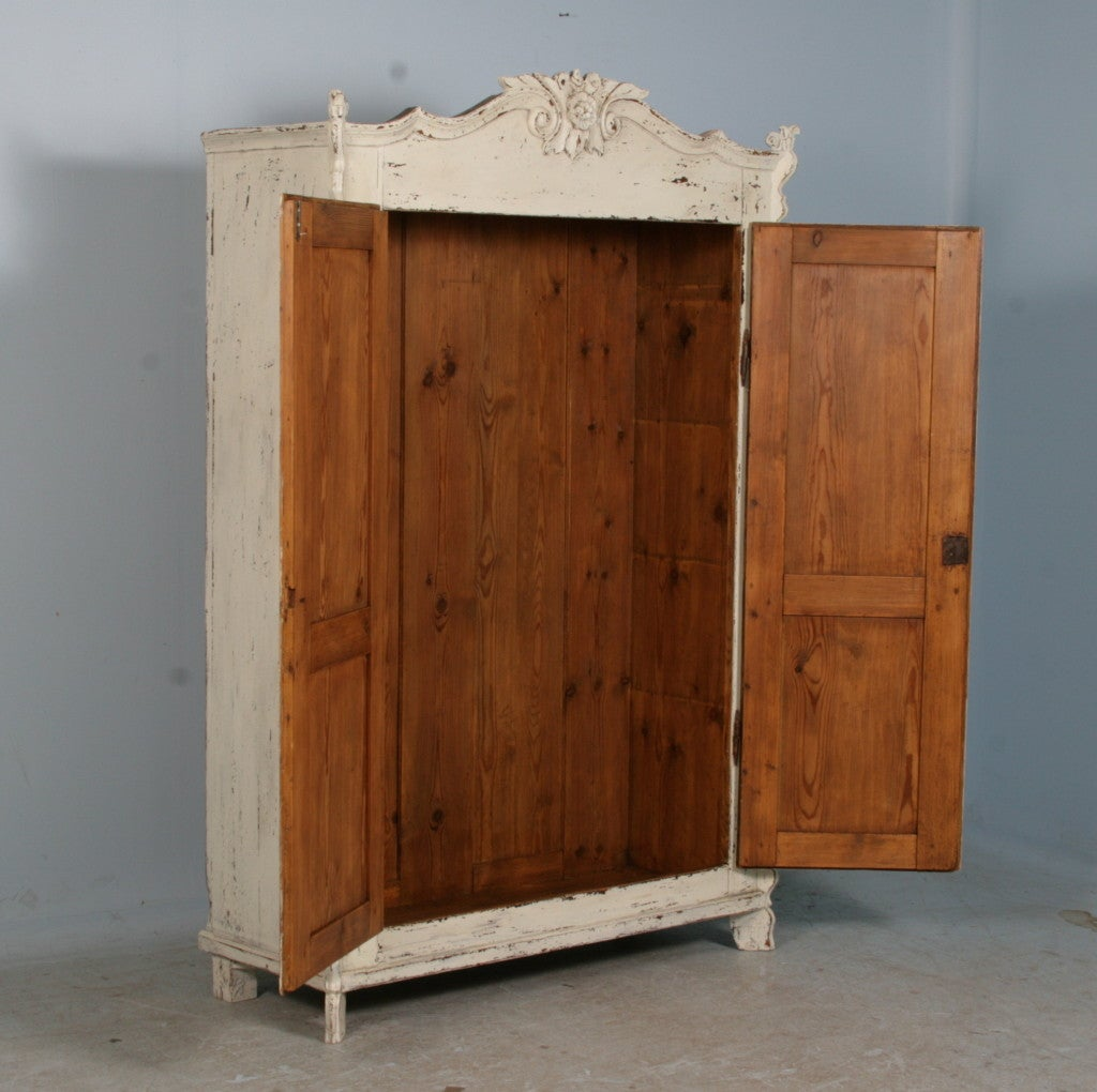 This Lovely Pine Armoire Has Been Given New Life With A White, Distressed  Painted Finish