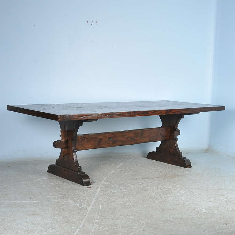 this large farmhouse trestle dining tables made from reclaimed wood is