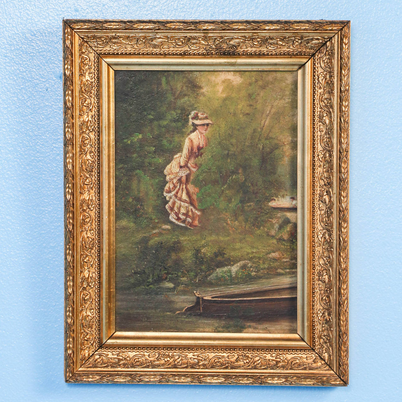 This delightful pair of oil on canvas paintings are being sold as a set. While the romantic couple are in the boat, another woman is spying upon them from behind the green shrubbery on the shore. They are both by the same unknown artist.