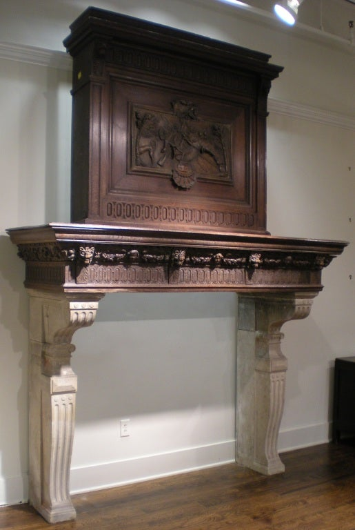 Impressive and monumental in size! Mantel is from Normandy, France. Chimney breast has an 18th century carved panel inset featuring animal figures deemed the trophy of the hunt. The rest of mantel is mid-19th century. Beautiful and unusually carved