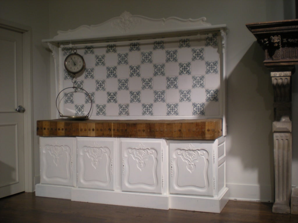French painted and carved four-door cabinet with butcher block top surface and tile backsplash. Also has a hanging utensil rod.