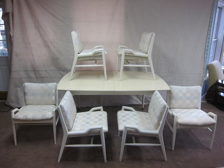 John Keal dining set with six chairs, table has two additional leaves for expansion. The whole set is in white lacquer including the additional leaves for the table. Table is 63 closed > open with leaves 93.  Condition is good.  Recommend new