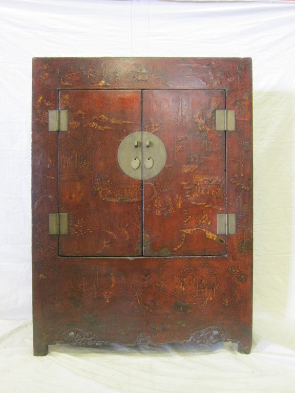 18th century large Chinese raised lacquer cabinet. This cabinet has a wonderful patina that only comes from time and old style craftsmanship lacquer application. A paper or cloth covering is placed over adobe to add dimension and depth to the