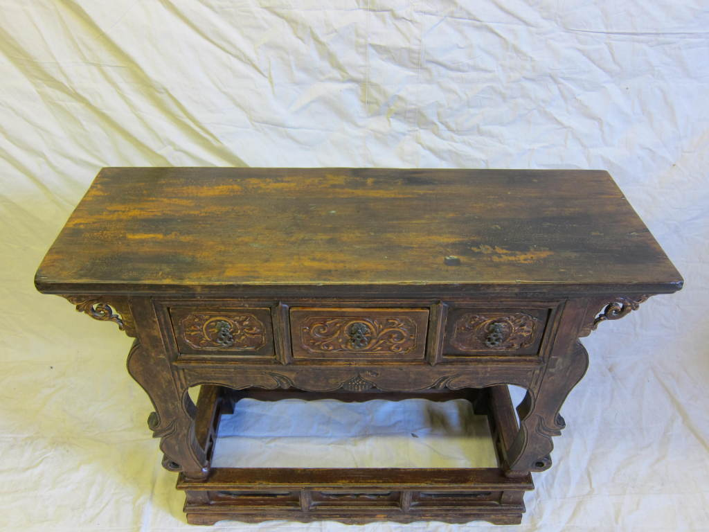 Imperial 19th Century Carved Wine Table raised on stand with three drawers.  Exceptional table having scalloped apron with carved spandrels and carved Rams legs front set on stand of importance.  A very significant table.      Chinese Altar table,
