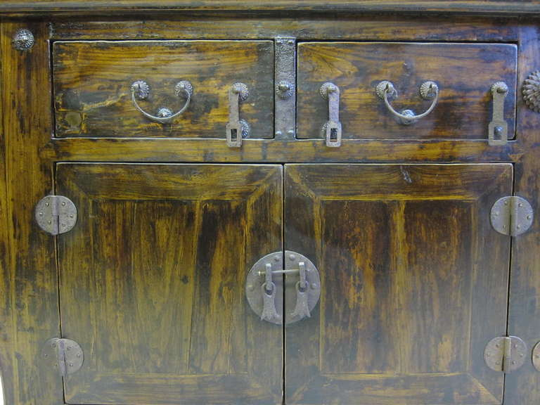 Impressive 19th century sideboard with cross over hardware, carved spandrels and original pins. Elmwood, Shanxi, circa 1800.