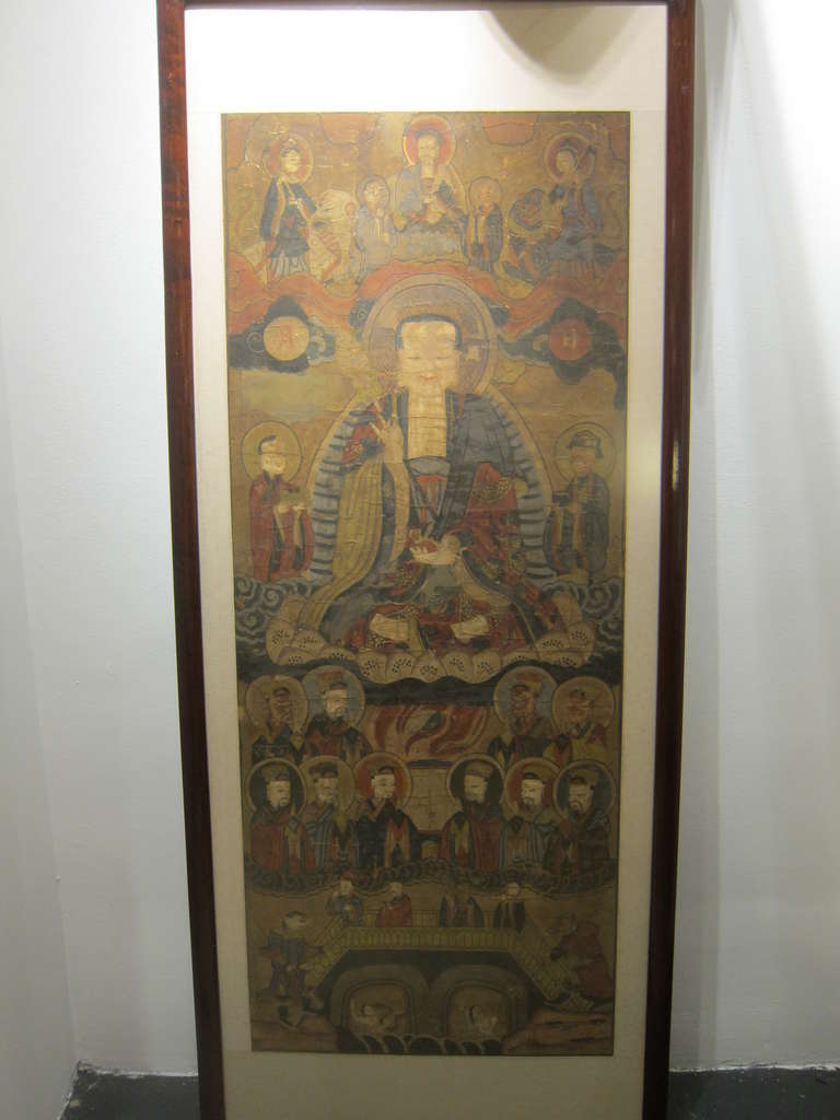 17th  century Buddhist Chinese Scroll Painting.  This is a temple piece and has been re-backed numerous times over its life span.  The practice of re-backing these types of scrolls paintings was common as part of continuing the use and life of the