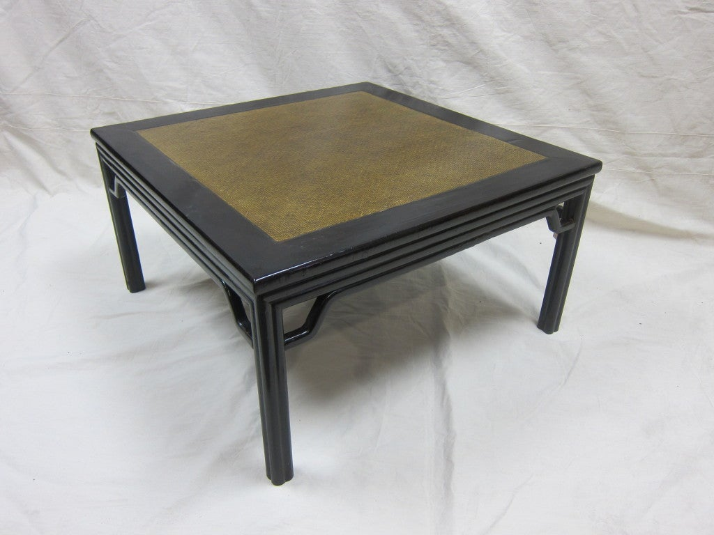 Spectacular Art Deco cocktail table, coffee table, side table, end table.  Art Deco period Chinese Rattan top table.  Having layered molding with humpback stretchers adding a softness to this refined style. Very good condition. The color appears