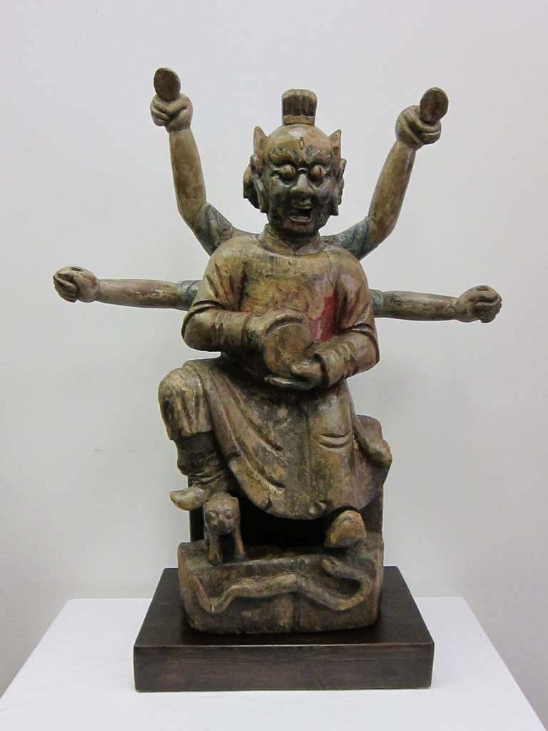 18th century or earlier Carved wooden Buddha Statue of Nezha; .   A wonderfully carved interpretation of the manifestation of the Chinese Buddha Nezha, displaying his three heads and six arms.  This statue represents the joining of Buddhist and