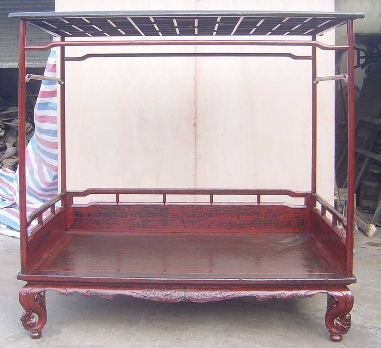 Wonderful 19th century Canopy Top Chinese Day Bed,  Walnut worn red lacquer with inset rattan platform. Humpback struts, intricately carved legs, raised on ball feet, with full Canopy top with screen detail. Circa 1800, Shanxi