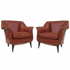Pair of Club Chairs by Carlo di Carli