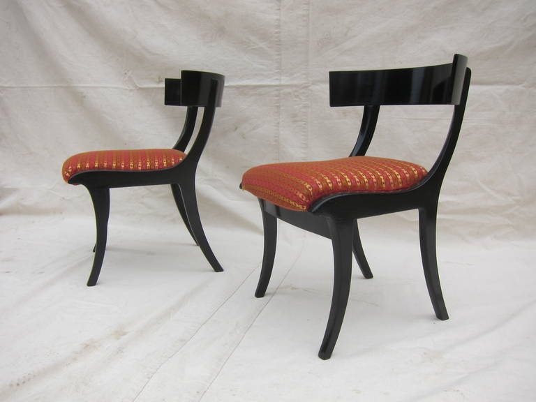 A pair 19th century Danish Klismos chairs. Ebonized hardwood with upholstery in very good condition.