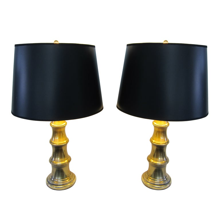 Paired Stiffel Faux Bamboo style brass lamps. Exclusive Design by Stiffel. Switch is on lamp base having three way function. Elegant in very good condition. Brass has patina. Polishing to look like new, available.