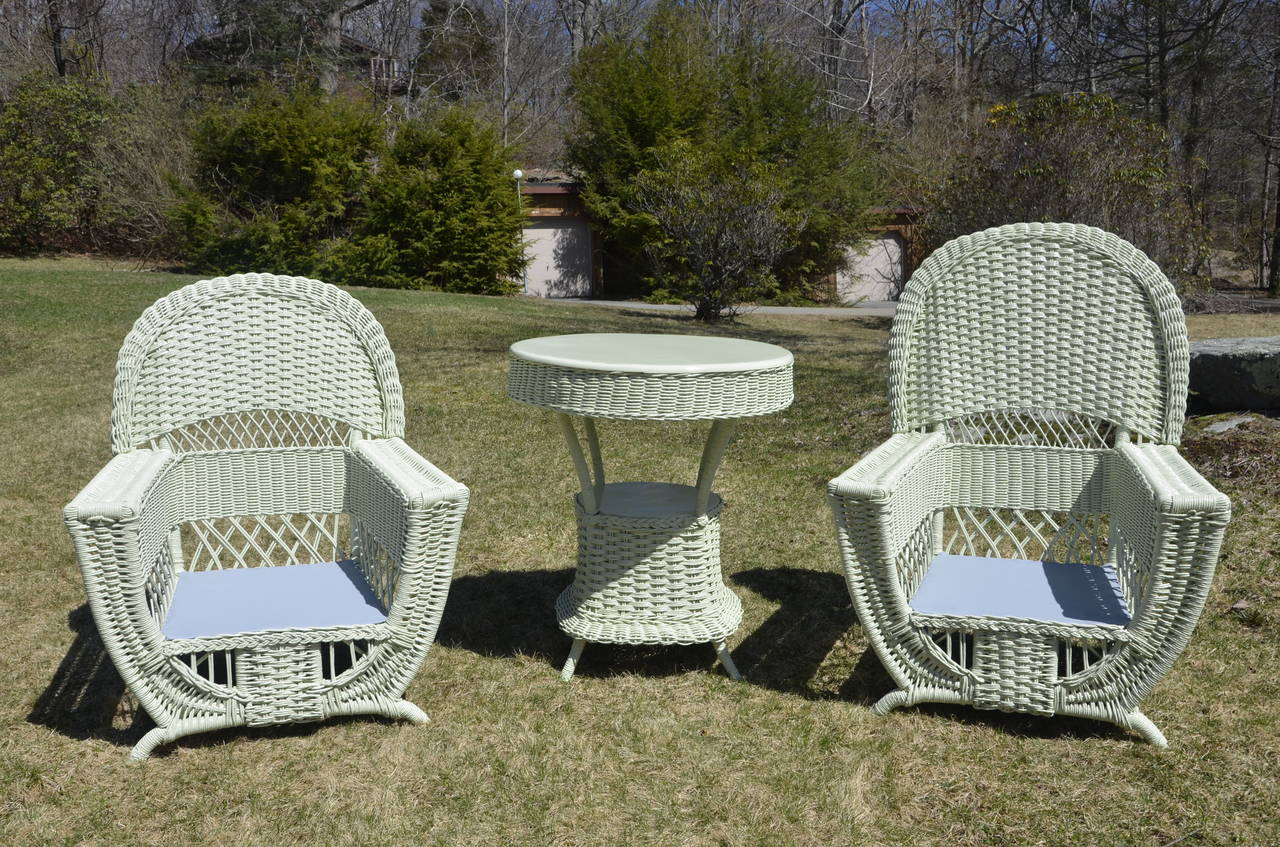 A beautiful and rare antique wicker parlor set freshly painted in Benjamin Moore Guilford Green. Table 32
