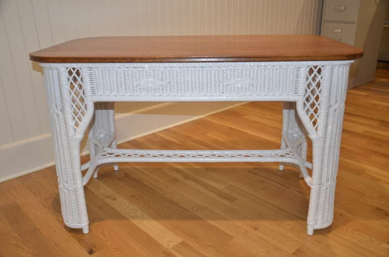 Antique wicker table with quarter sawn oak top.