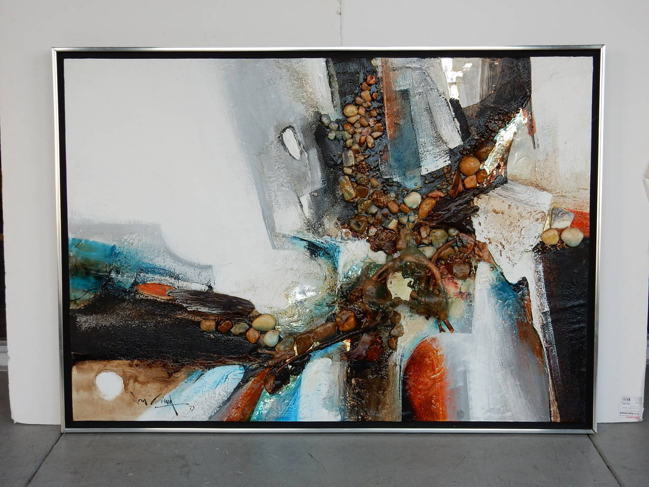 A very large and dynamic painting. Done in impasto and includes passages with rocks, woods and resin. Very interesting to say the least.
