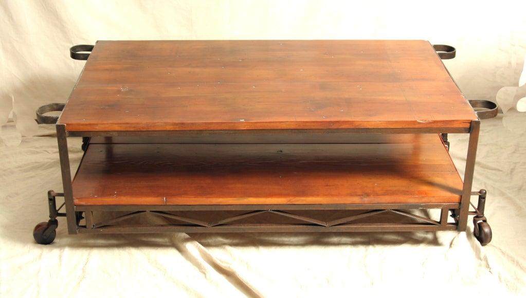 Industrial Coffee Table with Vintage Wood Wheels 2