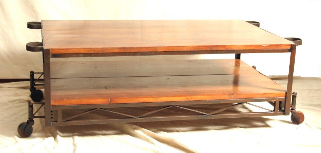 Industrial Coffee Table with Vintage Wood Wheels 4