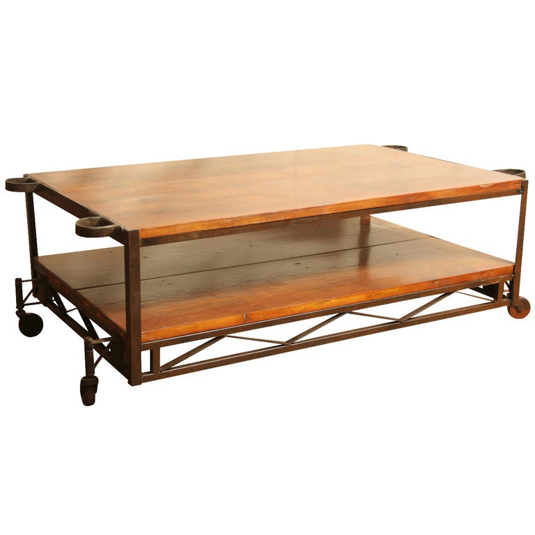 Industrial coffee table with vintage wood wheels at 1stdibs for Coffee tables on wheels