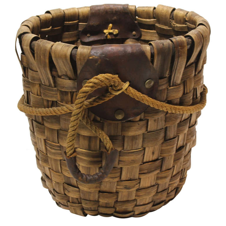 large woven rustic basket with leather handles at 1stdibs. Black Bedroom Furniture Sets. Home Design Ideas
