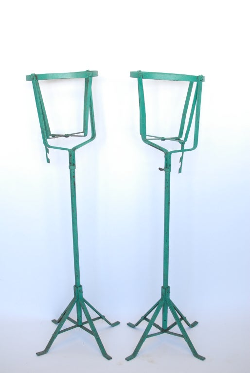 Great set of two 1900's metal American tall planters