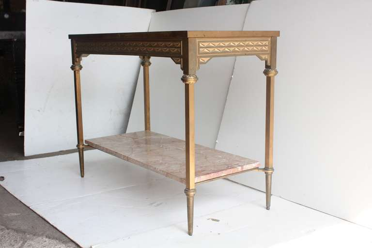 Art Deco style bronze console table with glass top and marble shelf.