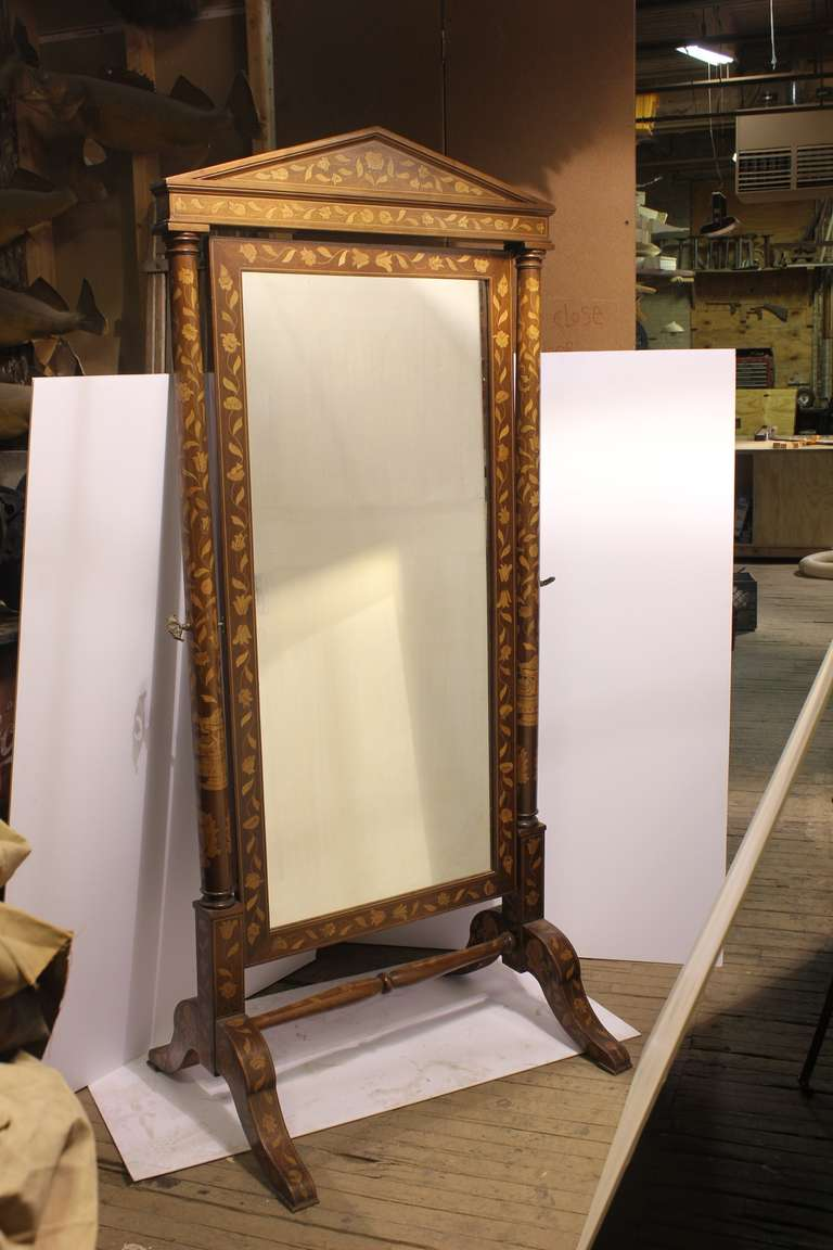 Elegant antique inlaid wood floor mirror.