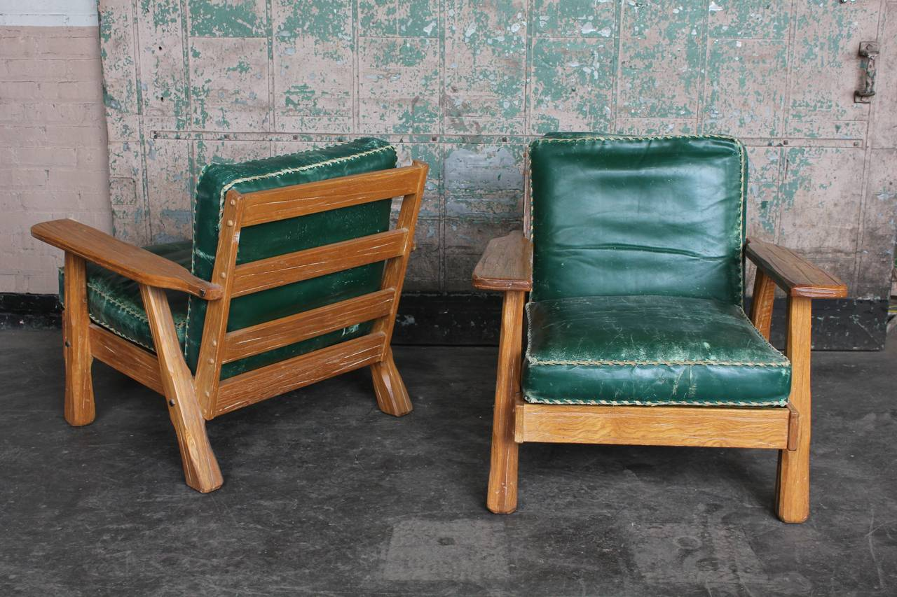 S leather and wood lounge chairs by ranch oak at stdibs