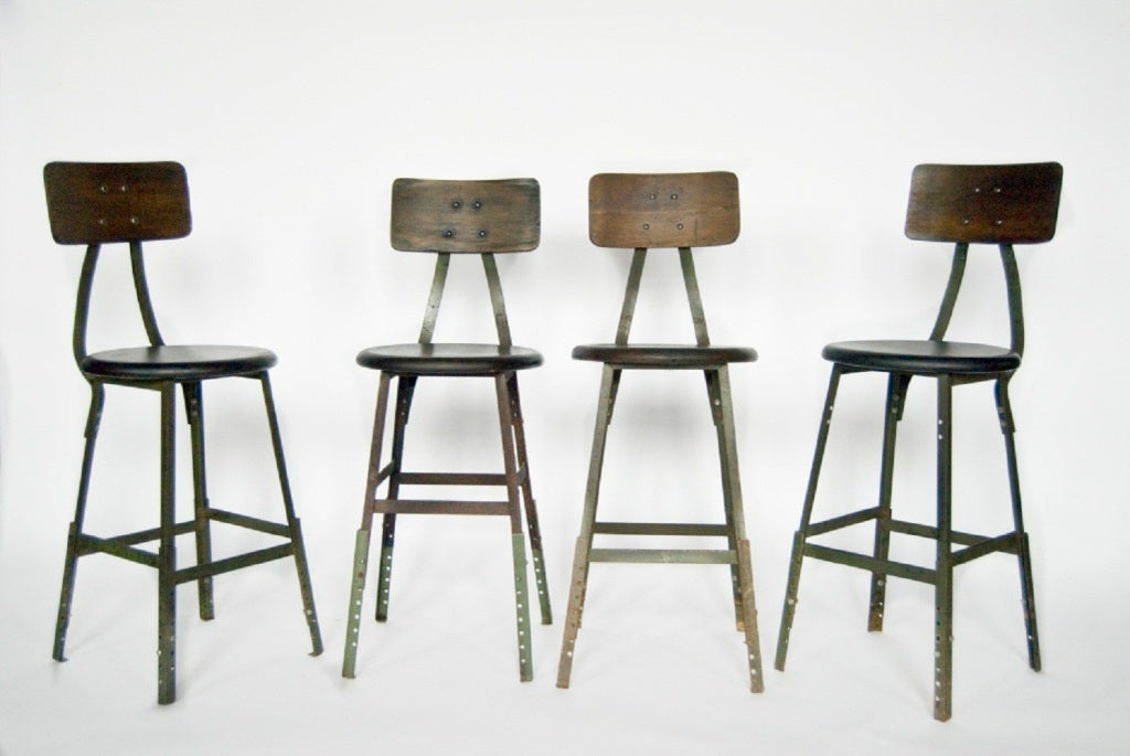 1940's American industrial stools with steel adjustable base and wooden seat and back. Listed price is for each stool.We have more available.
