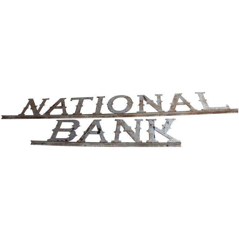 "1900's metal "" NATIONAL BANK "" sign"