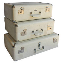 Stylish Mid-Century Faux Leather and Chrome Suitcases