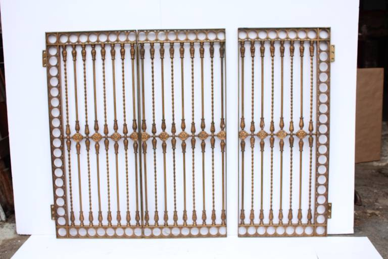 Antique ornate solid bronze three panel gate.