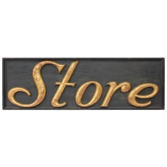 "Large Antique Gilded Cast Iron Sign, ""Store"""