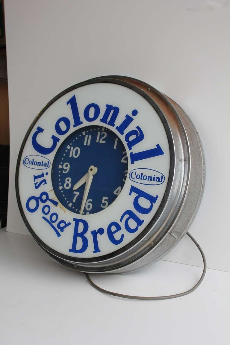 Great large 1950's green neon advertising clock for Colonial Bread.