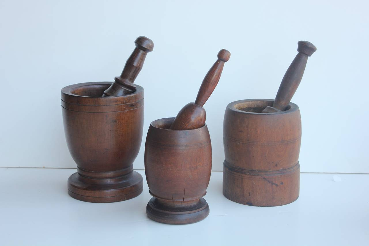 Collection of three antique wood mortars & pestles.
