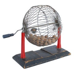 Vintage bingo cage with bakelite red stand and an handle
