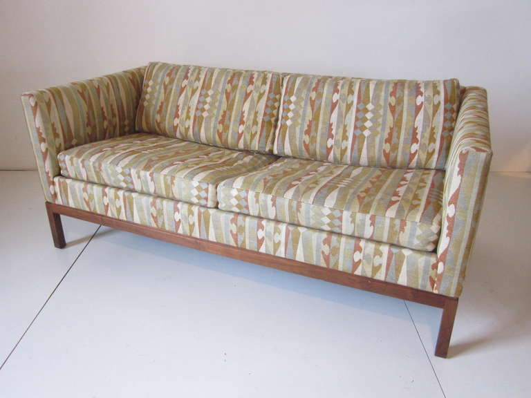 A Mid Century Walnut Framed Two Cushion Loveseat Covered In Designer Boris  Kroll Fabric. Manufactured