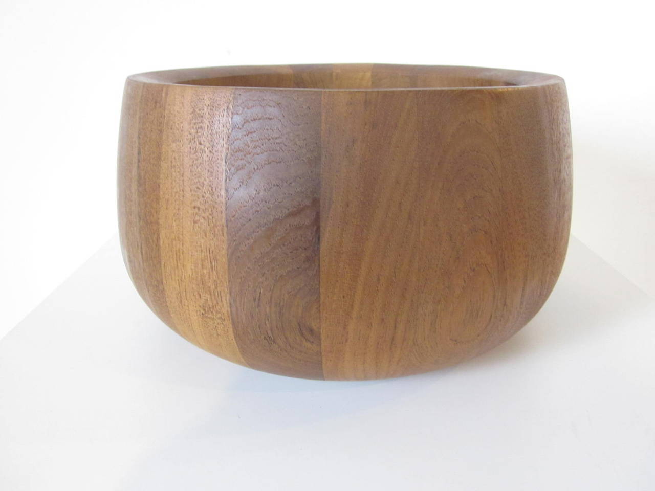 A teakwood salad bowl made by Dansk and designed by Jens Quistgaard great for a center piece or making that yummy salad .