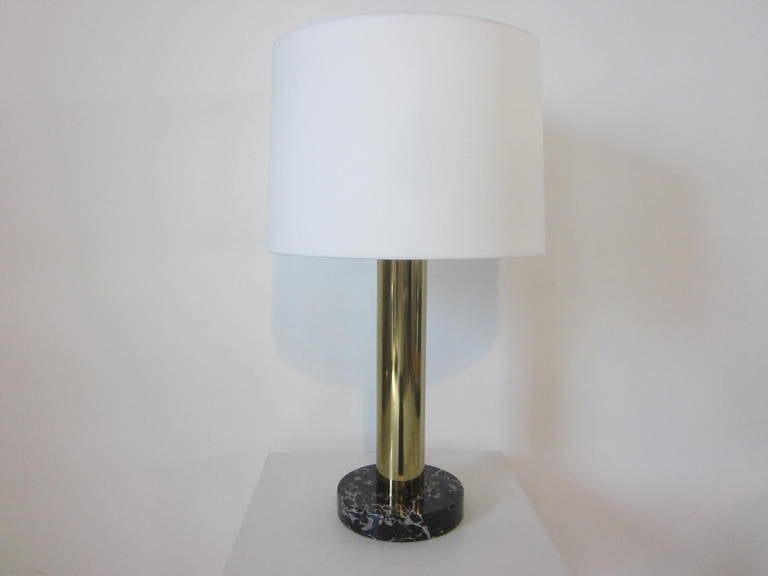 A brass and dark veined marble based table lamp with off-white linen shade manufactured by Nessen Lamp Company, NY .  Great for that home office or living space that needs some soft attractive lighting .