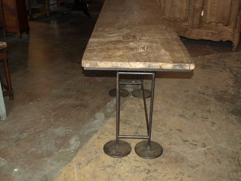 Industrial work table, console in oak and iron. Base France circa 1940's-1950's. Top single piece of 17th century French oak.