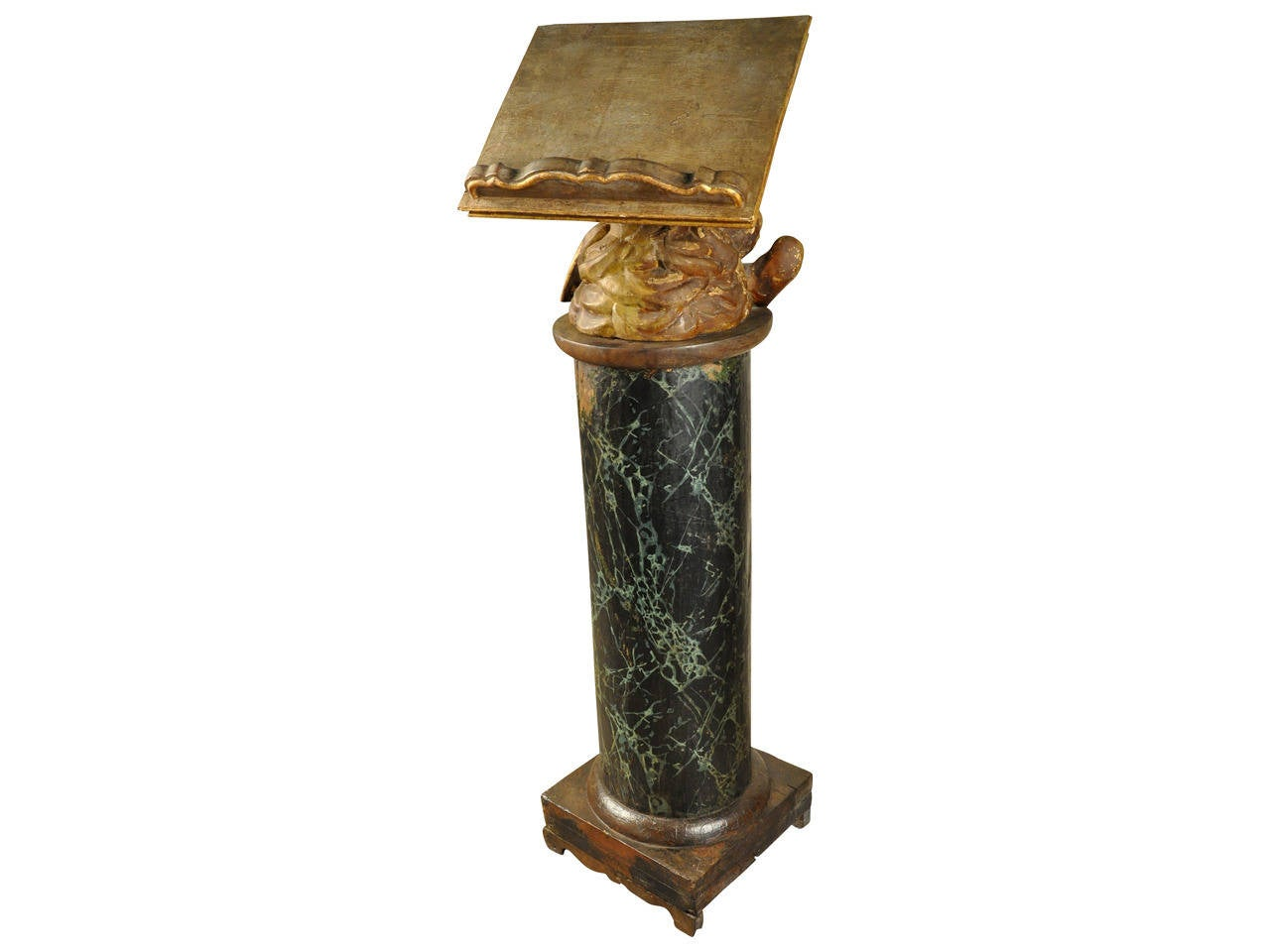A stunning and exceptional 17th century ecclesiastical lectern from the north of Italy. The solid wood column has a polychromed faux marble finish as verde antico marble. The putti support of the book rest is in giltwood and rotates. The book rest