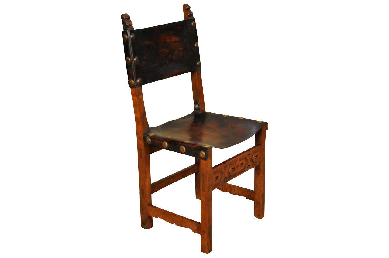 this set of six spanish 19th century leather dining chairs is no