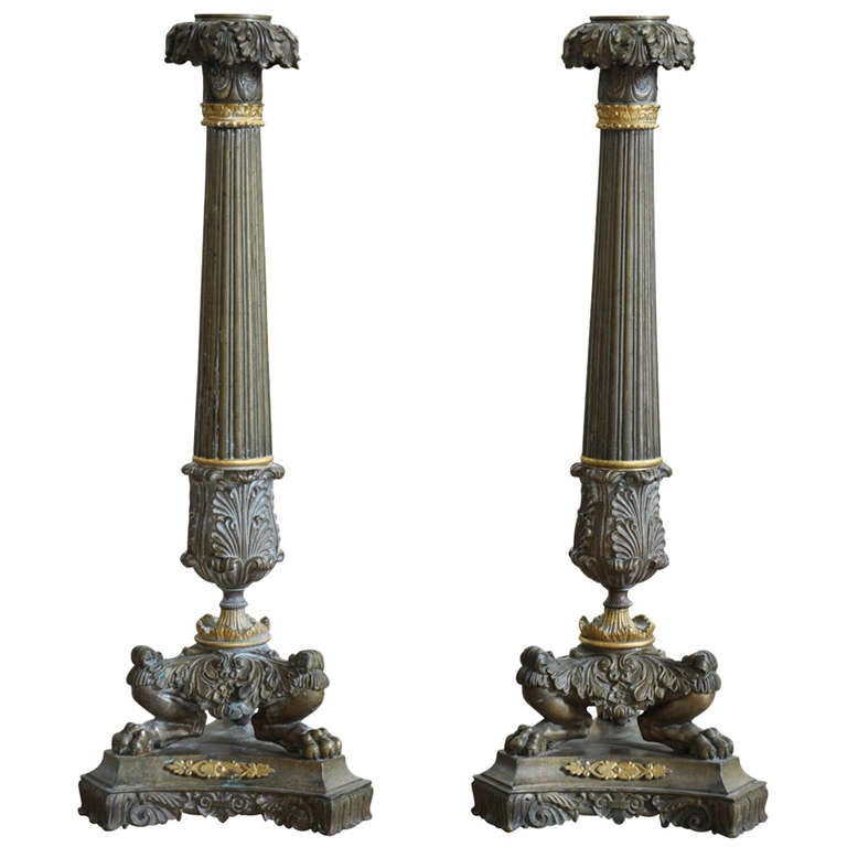 Pair of French Early 19th Century Candlesticks in Gilded Bronze