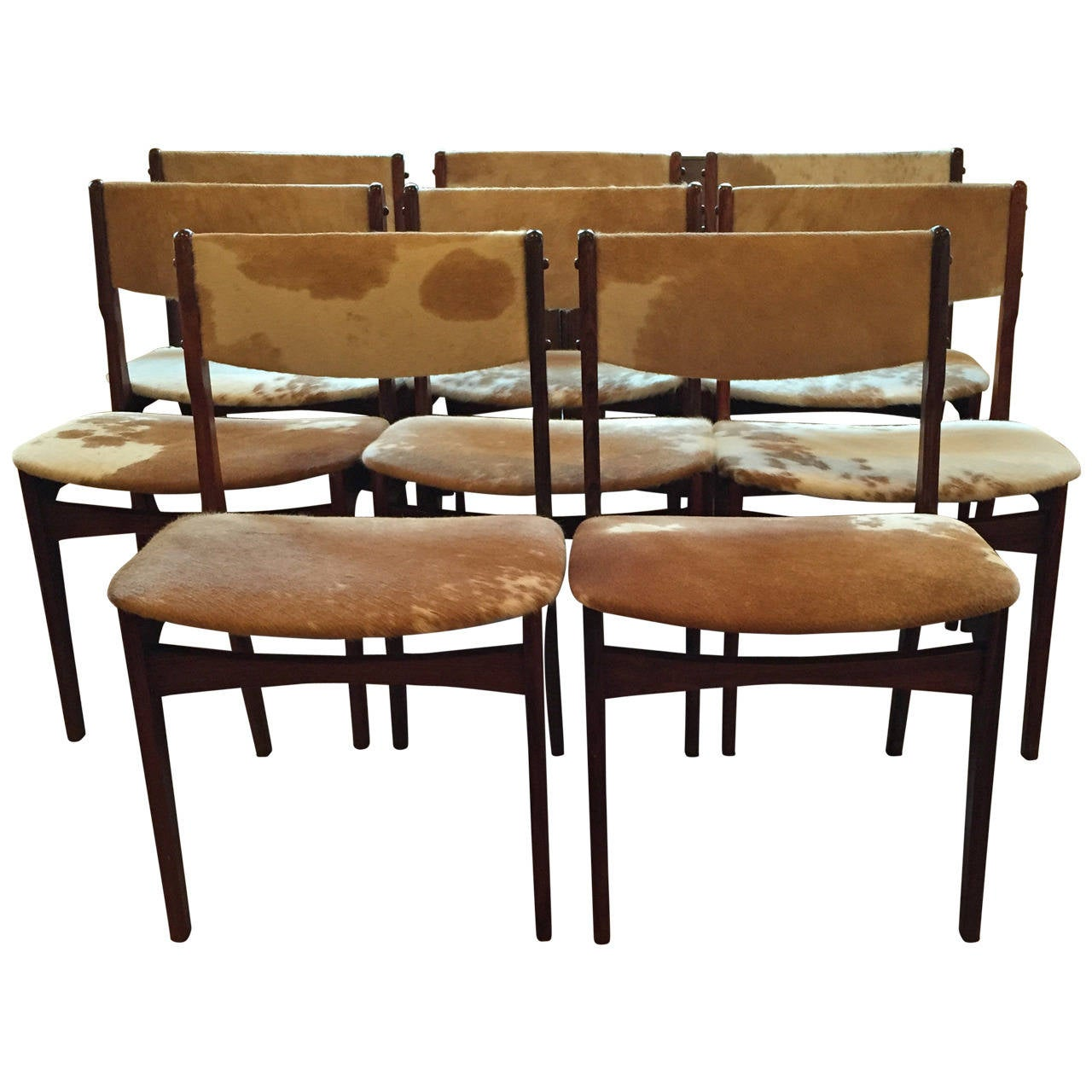Set of eight danish rosewood dining chairs dressed in cowhide at 1stdibs