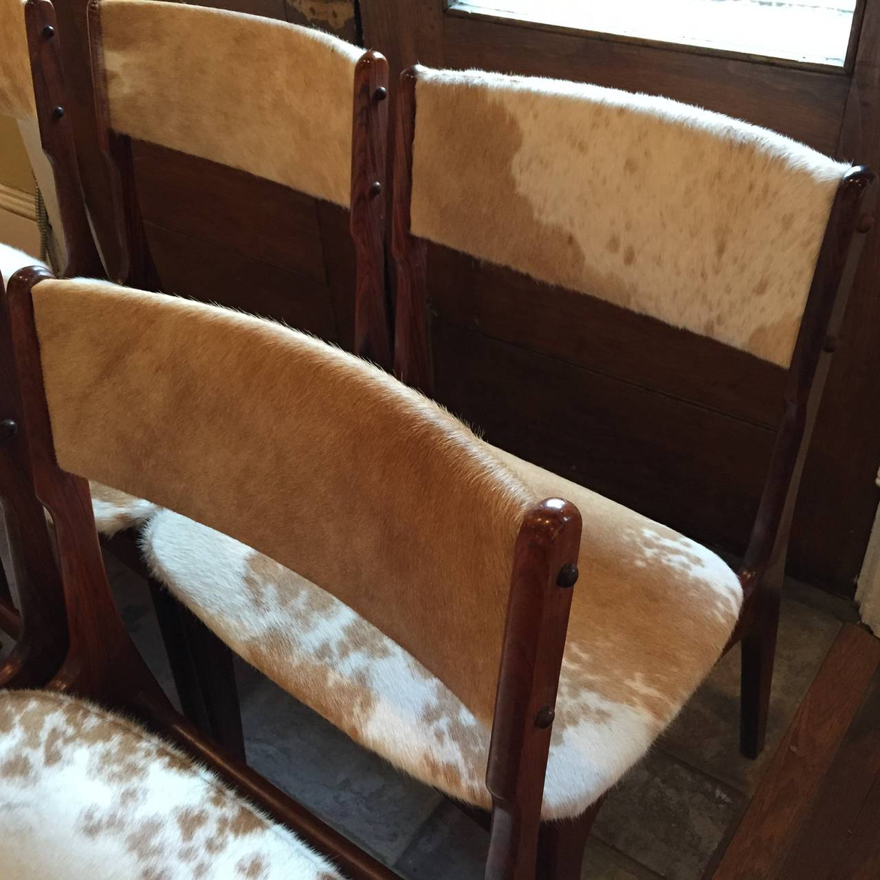 of eight danish rosewood dining chairs dressed in cowhide at 1stdibs