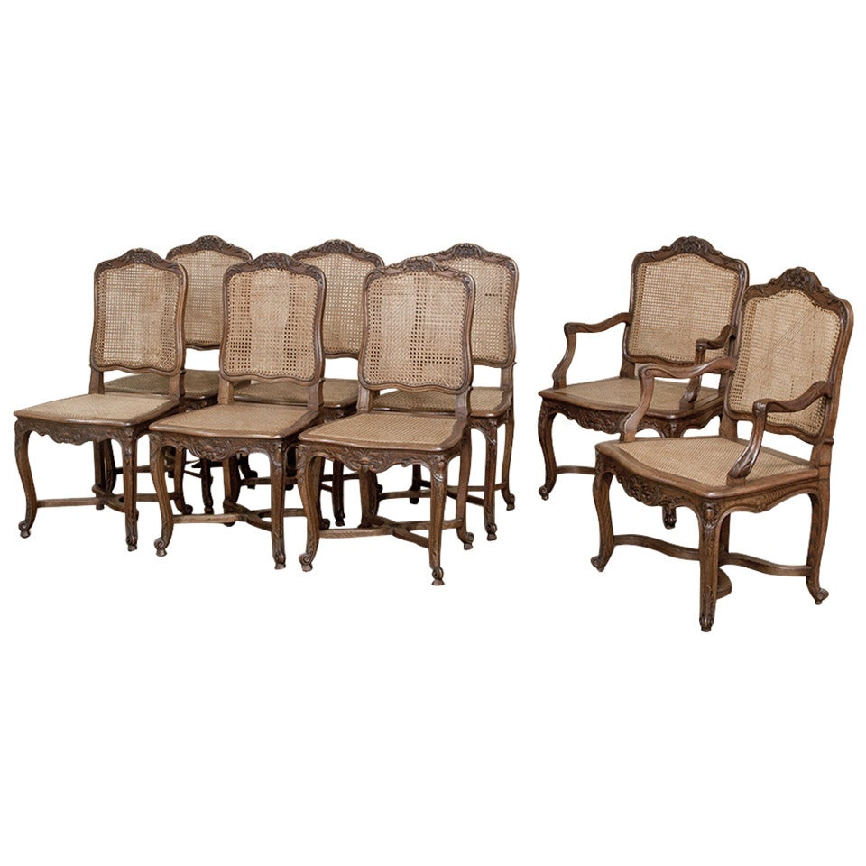 this set of eight country french dining chairs including two armchairs