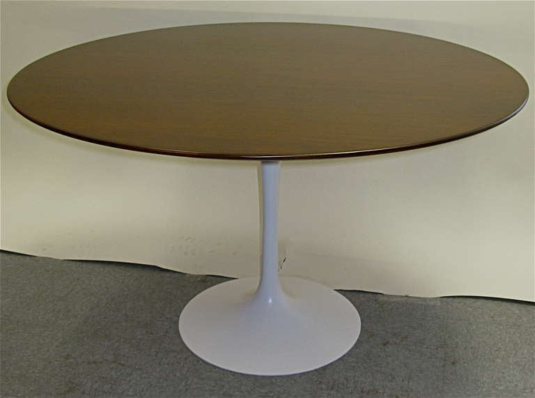Very nice 48 in. walnut top table. Very heavy iron base on the bottom.