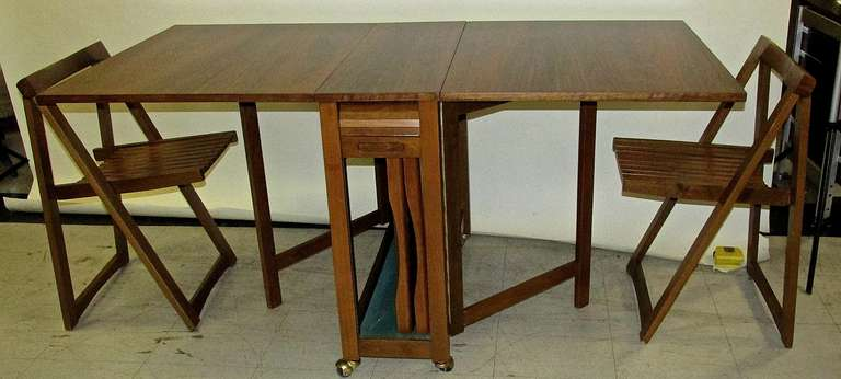 clever 1950 s drop leaf table with chairs inside at 1stdibs