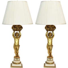 An exquisite and rare pair of lamps, by E.F. Caldwell.